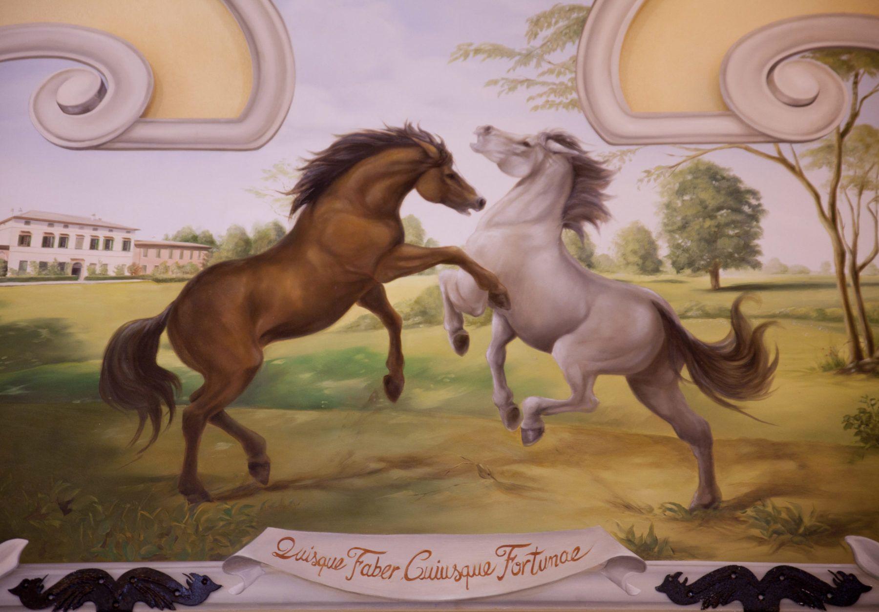 Un dipinto di cavalli in primo piano in natura con la facciata della cascina farisengo